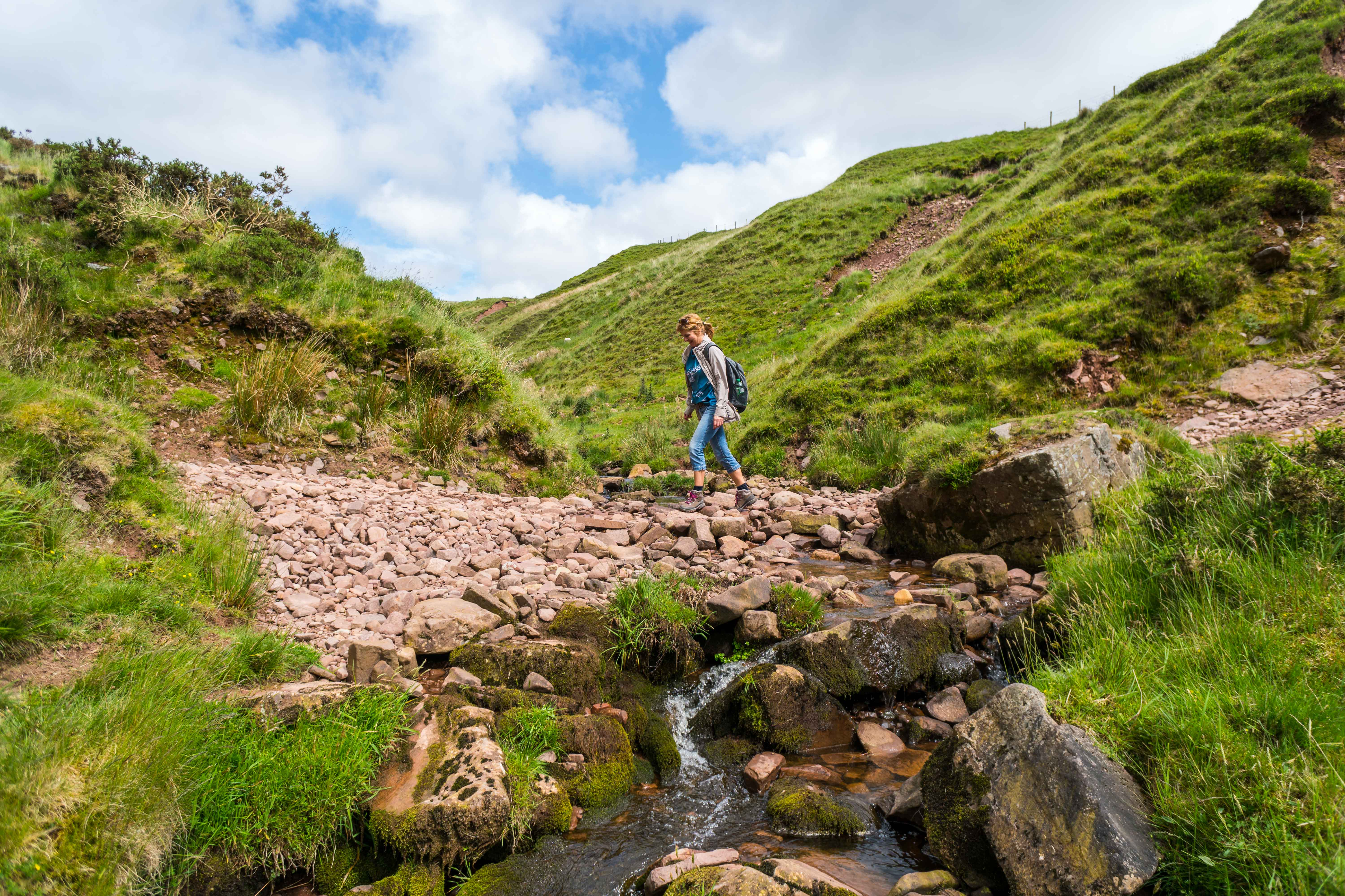 Walking over stream - Brecon Beacons