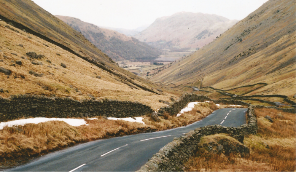 A road cutting through mountains in the Lake District
