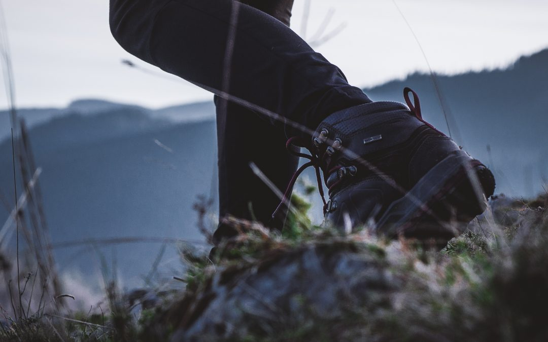 Girl wearing walking boots in long grass.